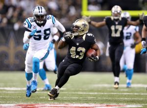 Dec 8, 2013; New Orleans, LA, USA; New Orleans Saints running back Darren Sproles (43) carries the ball in front of Carolina Panthers outside linebacker Thomas Davis (58) in the first half at the Mercedes-Benz Superdome. Mandatory Credit: Crystal LoGiudice-USA TODAY Sports
