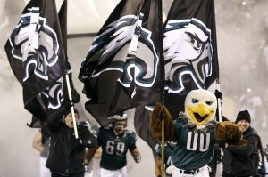 Jan 4, 2014; Philadelphia, PA, USA; Philadelphia Eagles mascot Swoop leads the Eagles players onto the field prior to their game against the New Orleans Saints in the 2013 NFC wild card playoff football game at Lincoln Financial Field. The Saints won 26-24. Mandatory Credit: Geoff Burke-USA TODAY Sports