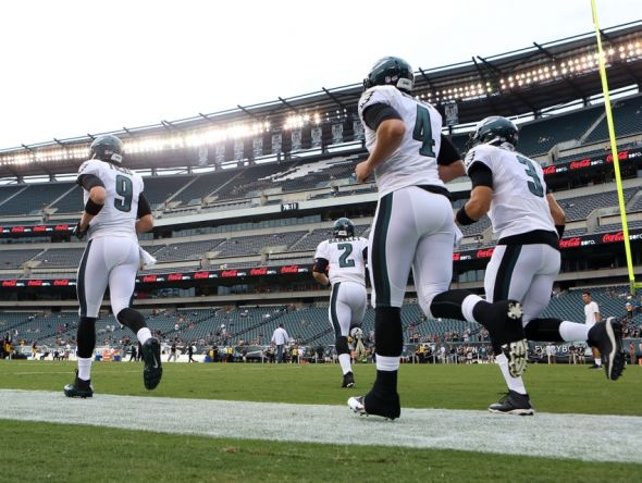 Aug 21, 2014; Philadelphia, PA, USA; Philadelphia Eagles quarterbacks Nick Foles (9) and quarterback Matt Barkley (2) and quarterback G.J. Kinne (4) and quarterback Mark Sanchez (3) take the field for warm ups. The Eagles depth chart at quarterback is nearly finalized. Mandatory Credit: Bill Streicher-USA TODAY Sports