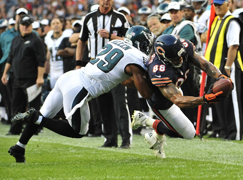 Aug 8, 2014; Chicago, IL, USA; Chicago Bears tight end Dante Rosario (88) catches a pass and is tackled by Philadelphia Eagles strong safety Nate Allen (29) in the first quarter during a preseason game at Soldier Field. Mandatory Credit: David Banks-USA TODAY Sports