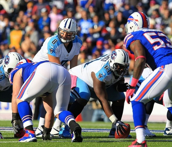 Oct 21, 2012; Orchard Park, NY, USA; Tennessee Titans quarterback Matt Hasselbeck (8) takes a snap from center Fernando Velasco (61) during the game against the Buffalo Bills at Ralph Wilson Stadium. Titans beat the Bills 35-34. Mandatory Credit: Kevin Hoffman-USA TODAY Sports