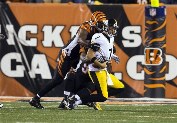 Sep 16, 2013; Cincinnati, OH, USA; Pittsburgh Steelers quarterback Ben Roethlisberger (7) is sacked by Cincinnati Bengals defensive end Michael Johnson (93) and defensive tackle Geno Atkins (97) at Paul Brown Stadium. Cincinnati won the game 20-10. Mandatory Credit: Greg Bartram-USA TODAY Sports