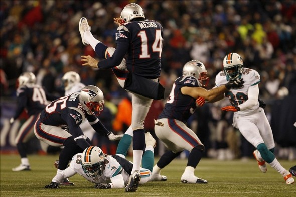 Dec 30, 2012; Foxborough, MA, USA; New England Patriots punter Zoltan Mesko (14) punts the ball against the Miami Dolphins during the second half at Gillette Stadium. The New England Patriots defeated the Miami Dolphins 28-0. Mandatory Credit: David Butler II-USA TODAY Sports