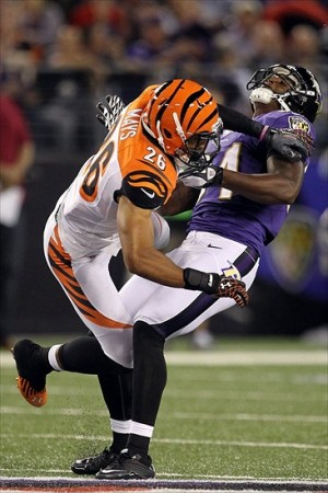 September 10, 2012; Baltimore, MD, USA; Cincinnati Bengals safety Taylor Mays (26) is called for a helmet to helmet hit penalty against Baltimore Ravens tight end Ed Dickson (84) at M
