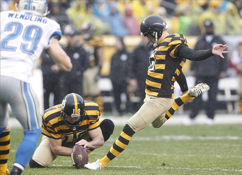 Nov 17, 2013; Pittsburgh, PA, USA; Pittsburgh Steelers kicker Shaun Suisham (right) kicks a 34 yard field goal against the Detroit Lions during the second quarter at Heinz Field. The Pittsburgh Steelers won 37-27. Mandatory Credit: Charles LeClaire-USA TODAY Sports