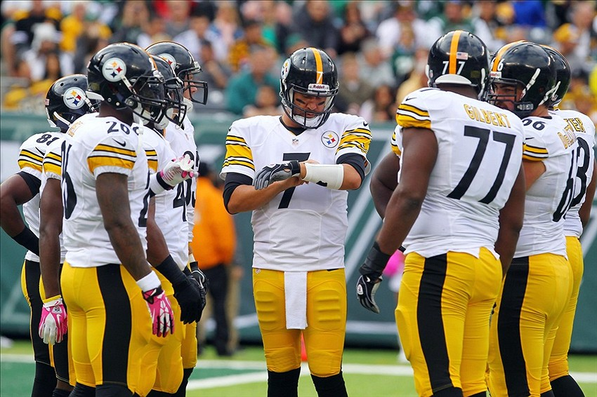 Oct 13, 2013; East Rutherford, NJ, USA; Pittsburgh Steelers quarterback Ben Roethlisberger (7) calls a play in the huddle during the first half of their game against the New York Jets at MetLife Stadium. Mandatory Credit: Ed Mulholland-USA TODAY Sports