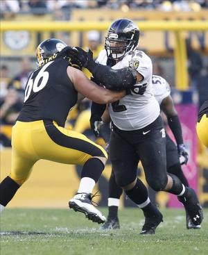Oct 20, 2013; Pittsburgh, PA, USA; Baltimore Ravens nose tackle Haloti Ngata (right) rushes the line of scrimmage against Pittsburgh Steelers guard David DeCastro (66) during the first quarter at Heinz Field. The Steelers won 19-16. Mandatory Credit: Charles LeClaire-USA TODAY Sports