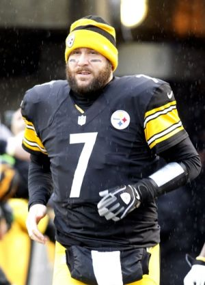 Dec 29, 2013; Pittsburgh, PA, USA; Pittsburgh Steelers quarterback Ben Roethlisberger (7) runs out of the tunnel for player introductions before playing the Cleveland Browns at Heinz Field. The Steelers won 20-7. Mandatory Credit: Charles LeClaire-USA TODAY Sports