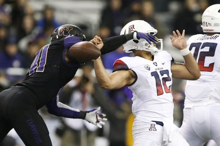 Travis-feeney-anu-solomon-ncaa-football-arizona-washington-768x511