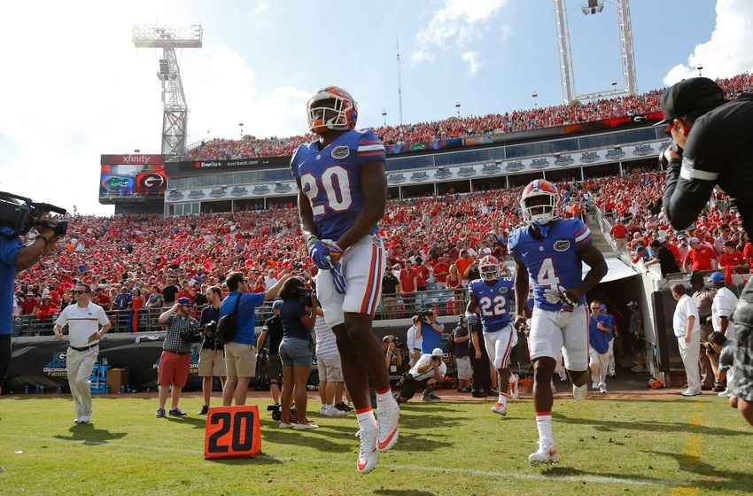 Oct 29, 2016; Jacksonville, FL, USA; Florida Gators defensive back Marcus Maye (20), wide receiver Brandon Powell (4) and teammates run out of the tunnel before the game against the Georgia Bulldogs at EverBank Field. Mandatory Credit: Kim Klement-USA TODAY Sports