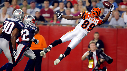 Bengals wideout Jerome Simpson makes a fingertip grab in the end zone in the second quarter.