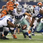Aug 24, 2013; Arlington, TX, USA; Dallas Cowboys running back DeMarco Murray (29) tight end Gavin Escobar (89) and tackle Jermey Parnell (78) fight for a loose ball in the first quarter against the Cincinnati Bengals at AT