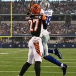 Aug 24, 2013; Arlington, TX, USA; Dallas Cowboys receiver Dez Bryant (88) makes a touchdown catch against Cincinnati Bengals cornerback Dre Kirkpatrick (27) at AT