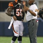 Aug 24, 2013; Arlington, TX, USA; Cincinnati Bengals head coach Marvin Lewis talks with linebacker Vontaze Burfict (55) during a timeout in the second quarter against the Dallas Cowboys at AT