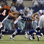 Aug 24, 2013; Arlington, TX, USA; Dallas Cowboys center Travis Frederick (70) in game action during the first quarter of the game against the Cincinnati Bengals at AT