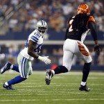 Aug 24, 2013; Arlington, TX, USA; Dallas Cowboys wide receiver Dez Bryant (88) runs with the ball while defended by Cincinnati Bengals free safety Reggie Nelson (20) during the second quarter of the game at AT