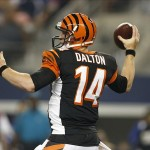 Aug 24, 2013; Arlington, TX, USA; Cincinnati Bengals quarterback Andy Dalton (14) throws a pass in the second quarter of the game against the Dallas Cowboys at AT