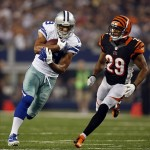 Aug 24, 2013; Arlington, TX, USA; Dallas Cowboys wide receiver Miles Austin (19) runs with the ball after catching a pass against the Cincinnati Bengals cornerback Leon Hall (29) in the second quarter at AT
