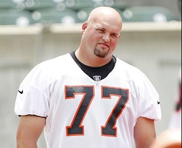 Jun 12, 2012; Cincinnati, OH, USA; Cincinnati Bengals tackle Andrew Whitworth (77) watches work outs at mini camp at Paul Brown Stadium. Mandatory Credit: Frank Victores-USA TODAY Sports
