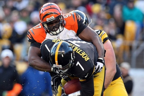 Dec 23, 2012; Pittsburgh, PA, USA; Pittsburgh Steelers quarterback Ben Roethlisberger (7) is sacked by Cincinnati Bengals defensive tackle Geno Atkins (97) during the second half of the game at Heinz Field. The Bengals won the game, 13-10. Mandatory Credit: Jason Bridge-USA TODAY Sports