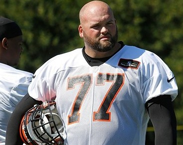 Jul 25, 2013; Cincinnati, OH, USA; Cincinnati Bengals tackle Andrew Whitworth (77) takes a break during training camp at Paul Brown Stadium. Mandatory Credit: David Kohl-USA TODAY Sports