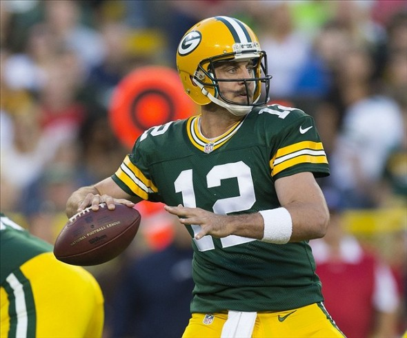 Aug 23, 2013; Green Bay, WI, USA; Green Bay Packers quarterback Aaron Rodgers (12) throws a pass during the first quarter against the Seattle Seahawks at Lambeau Field. Mandatory Credit: Jeff Hanisch-USA TODAY Sports