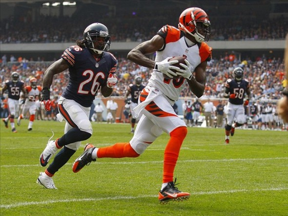Sep 8, 2013; Chicago, IL, USA; Cincinnati Bengals wide receiver A.J. Green (18) catches a 45 yard touchdown pass over Chicago Bears cornerback Tim Jennings (26) during the second quarter at Soldier Field. Mandatory Credit: Dennis Wierzbicki-USA TODAY Sports