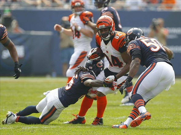 Sep 8, 2013; Chicago, IL, USA; Cincinnati Bengals tight end Jermaine Gresham (center) is tackled by Chicago Bears cornerback Tim Jennings (left) and Chicago Bears outside linebacker James Anderson (right) during the second quarter at Soldier Field. Mandatory Credit: Dennis Wierzbicki-USA TODAY Sports