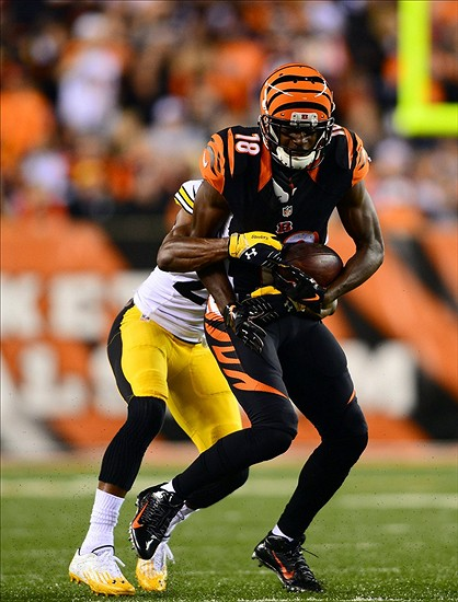 Sep 16, 2013; Cincinnati, OH, USA; Cincinnati Bengals wide receiver A.J. Green (18) makes a catch and is tackled by Pittsburgh Steelers cornerback Ike Taylor (24) during the fourth quarter at Paul Brown Stadium. Mandatory Credit: Andrew Weber-USA TODAY Sports