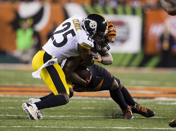 Sep 16, 2013; Cincinnati, OH, USA; Cincinnati Bengals tight end Tyler Eifert (85) is tackled by Pittsburgh Steelers free safety Ryan Clark (25) at Paul Brown Stadium. Cincinnati won the game 20-10. Mandatory Credit: Greg Bartram-USA TODAY Sports