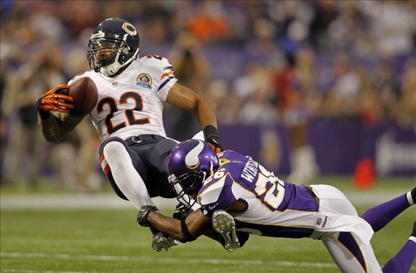 Dec 9, 2012; Minneapolis, MN, USA; Minnesota Vikings cornerback Antoine Winfield (26) tackles Chicago Bears running back Matt Forte (22) during the first quarter at the Metrodome. Mandatory Credit: Bruce Kluckhohn-USA TODAY Sports