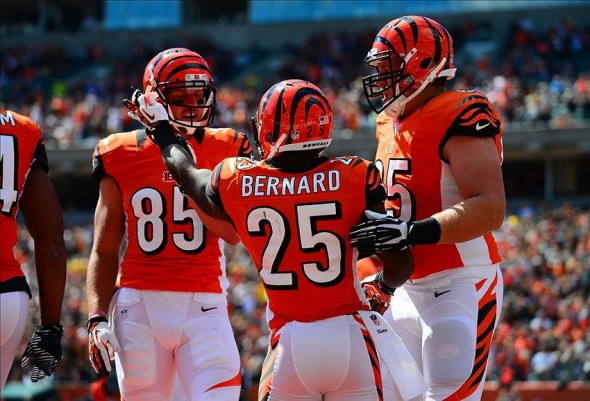 Sep 22, 2013; Cincinnati, OH, USA; Cincinnati Bengals running back Giovani Bernard (25) celebrates after scoring a touchdown during the first quarter against the Green Bay Packers at Paul Brown Stadium. Mandatory Credit: Andrew Weber-USA TODAY Sports