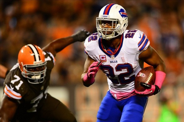 Oct 3, 2013; Cleveland, OH, USA; Buffalo Bills running back Fred Jackson (22) rushes into the end zone for at touchdown during the third quarter against the Cleveland Browns at FirstEnergy Stadium. Mandatory Credit: Andrew Weber-USA TODAY Sports