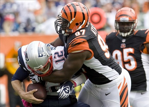 Oct 6, 2013; Cincinnati, OH, USA; Cincinnati Bengals defensive lineman Geno Atkins (97) sacks New England Patriots quarterback Tom Brady (12) in the first quarter at Paul Brown Stadium. Mandatory Credit: Mark Zerof-USA TODAY Sports