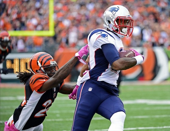 Oct 6, 2013; Cincinnati, OH, USA; New England Patriots wide receiver Aaron Dobson (17) evades a tackle from Cincinnati Bengals cornerback Adam Jones (24) in the second half of the game at Paul Brown Stadium. The Bengals won 13-6. Mandatory Credit: Marc Lebryk-USA TODAY Sports