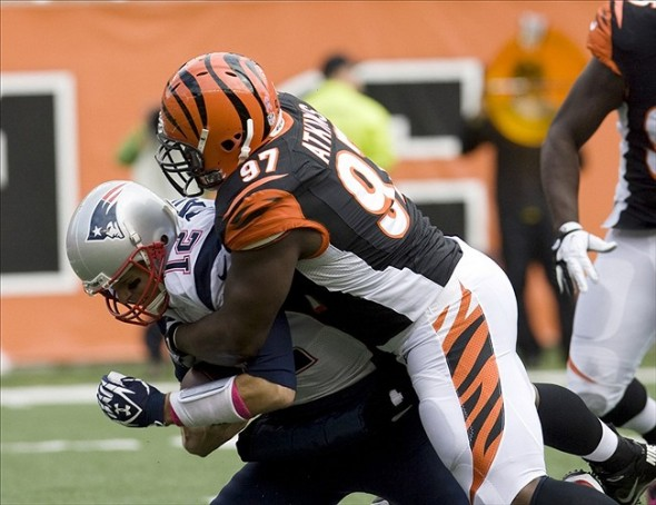 Oct 6, 2013; Cincinnati, OH, USA; Cincinnati Bengals defensive lineman Geno Atkins (97) sacks New England Patriots quarterback Tom Brady (12) in teh first half at Paul Brown Stadium. Cincinnati defeated New England 13-6. Mandatory Credit: Mark Zerof-USA TODAY Sports