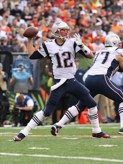 Oct 6, 2013; Cincinnati, OH, USA; New England Patriots quarterback Tom Brady (12) passes the ball against the Cincinnati Bengals at Paul Brown Stadium. Cincinnati defeated New England 13-6. Mandatory Credit: Mark Zerof-USA TODAY Sports