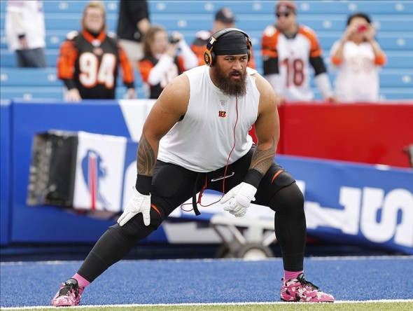 Oct 13, 2013; Orchard Park, NY, USA; Cincinnati Bengals defensive tackle Domata Peko (94) stretches before the game against the Buffalo Bills at Ralph Wilson Stadium. Mandatory Credit: Kevin Hoffman-USA TODAY Sports