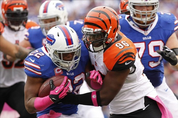Oct 13, 2013; Orchard Park, NY, USA; Cincinnati Bengals defensive end Carlos Dunlap (96) tackles Buffalo Bills running back Fred Jackson (22) during the first half at Ralph Wilson Stadium. Mandatory Credit: Kevin Hoffman-USA TODAY Sports