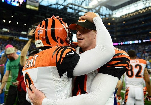 Oct 20, 2013; Detroit, MI, USA; Cincinnati Bengals kicker Mike Nugent (2) celebrates with quarterback Andy Dalton after kicking the game winning field goal to defeat the Detroit Lions 27-24 at Ford Field. Mandatory Credit: Andrew Weber-USA TODAY Sports