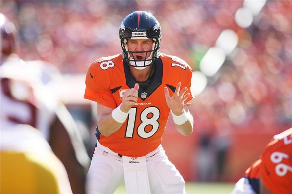 Oct 27, 2013; Denver, CO, USA; Denver Broncos quarterback Peyton Manning (18) calls out a play at the line of scrimmage during the first half against the Washington Redskins at Sports Authority Field at Mile High. Mandatory Credit: Chris Humphreys-USA TODAY Sports