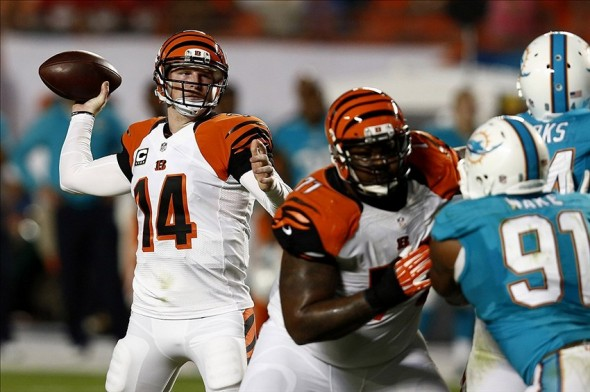 Oct 31, 2013; Miami Gardens, FL, USA; Cincinnati Bengals quarterback Andy Dalton (14) passes the ball against the Cincinnati Bengals in the first quarter at Sun Life Stadium. Mandatory Credit: Robert Mayer-USA TODAY Sports