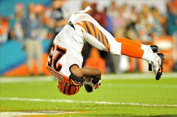 Oct 31, 2013; Miami Gardens, FL, USA; Cincinnati Bengals running back Gio Bernard (25) dives in for a touchdown during the fourth quarter against the Miami Dolphins at Sun Life Stadium. Mandatory Credit: Steve Mitchell-USA TODAY Sports