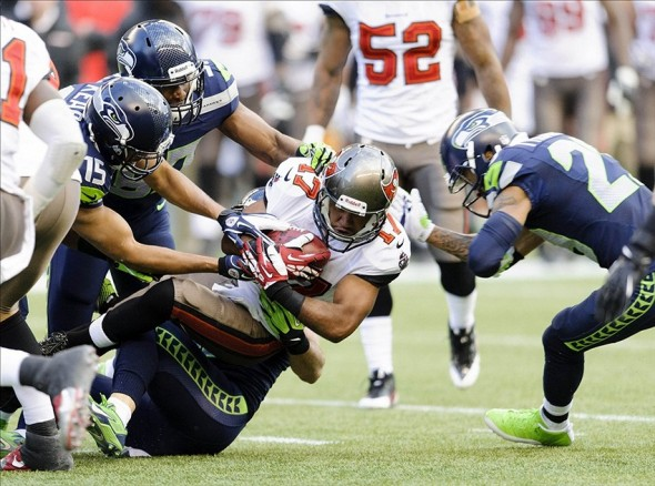 Nov 3, 2013; Seattle, WA, USA; Tampa Bay Buccaneers specialist Eric Page (17) dives forward during a kickoff return during the 2nd half at CenturyLink Field. Seattle defeated Tampa Bay 27-24. Mandatory Credit: Steven Bisig-USA TODAY Sports