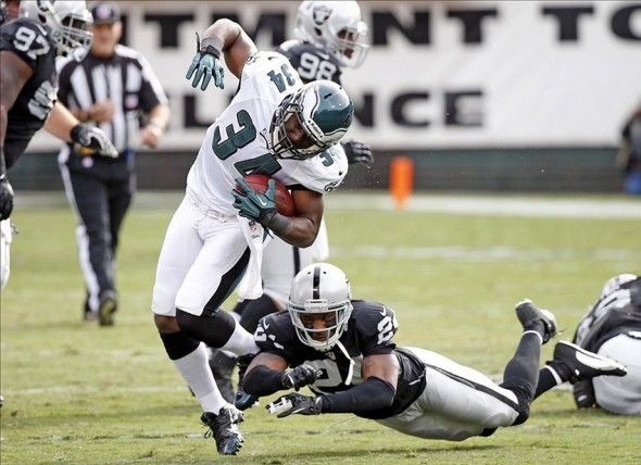 Nov 3, 2013; Oakland, CA, USA; Oakland Raiders running back Latavius Murray (34) rushes for a first down during the first half against the Philadelphia Eagles at O.co Coliseum. The Eagles won 49-20. Mandatory Credit: Bob Stanton-USA TODAY Sports