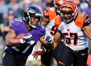 Nov 10, 2013; Baltimore, MD, USA; Baltimore Ravens running back Ray Rice (27) runs with the ball as Cincinnati Bengals linebacker Vincent Rey (57) defends at M