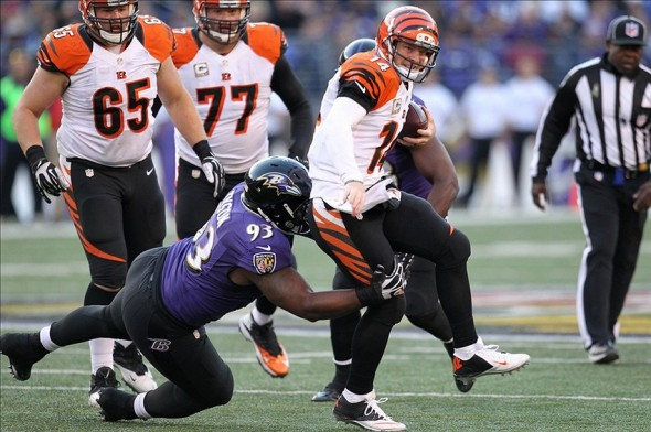 Nov 10, 2013; Baltimore, MD, USA; Cincinnati Bengals quarterback Andy Dalton (14) is sacked by Baltimore Ravens defensive end DeAngelo Tyson (93) at M