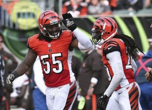 Nov 17, 2013; Cincinnati, OH, USA; Cleveland Browns offensive lineman Alex Mack (55) celebrates with safety Taylor Mays (26) during the game against the Cleveland Browns at Paul Brown Stadium. Mandatory Credit: Mark Zerof-USA TODAY Sports