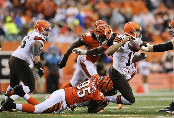 Nov 17, 2013; Cincinnati, OH, USA; Cincinnati Bengals defensive end Wallace Gilberry (95) causes Cleveland Browns quarterback Jason Campbell (17) to fumble during the game at Paul Brown Stadium. Mandatory Credit: Kevin Jairaj-USA TODAY Sports