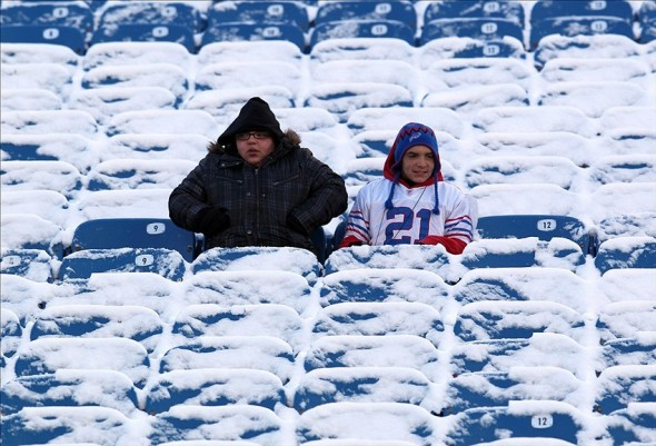 Dec. 30, 2012; Orchard Park, NY, USA; Fans sit in the snow covered seats before a game between the Buffalo Bills and the New York Jets at Ralph Wilson Stadium. Mandatory Credit: Timothy T. Ludwig-USA TODAY Sports